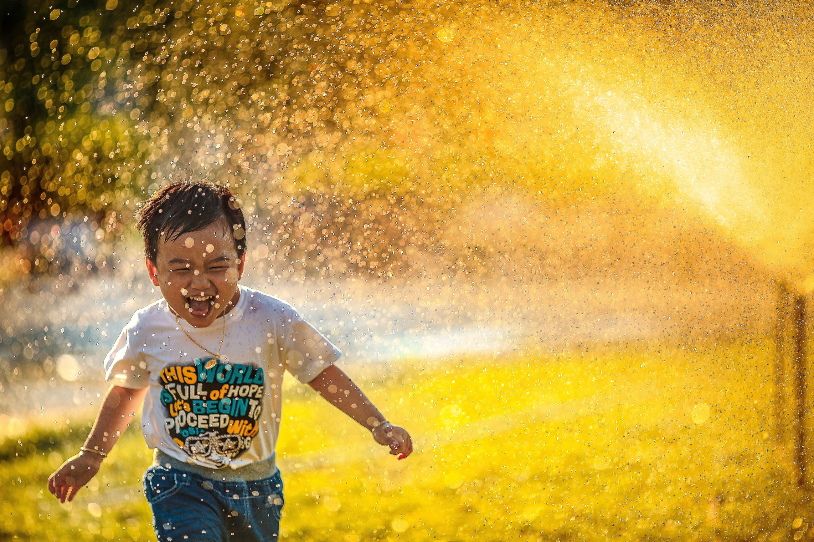 Kid in Sprinkler