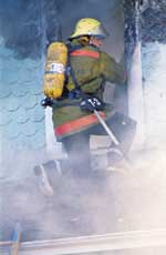 Firefighter going into burning building