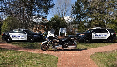 2 police cars 1 Police Motorcycle