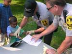 Police Officer fingerprinting a child